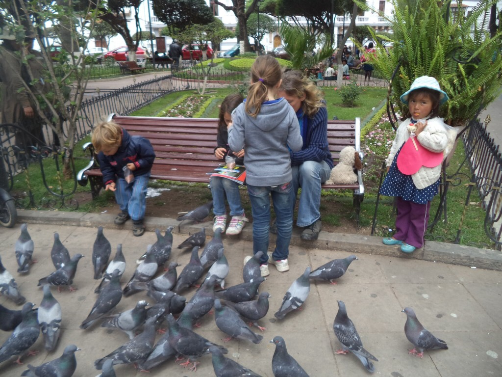 Feeding the pigeons in Sucre, Bolivia.